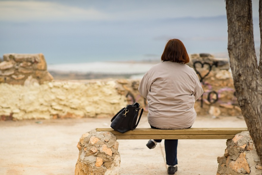 woman sitting by herself on a bench