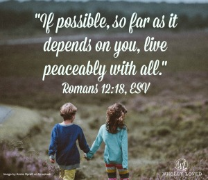 two children holding hands and text of Romans 12:18